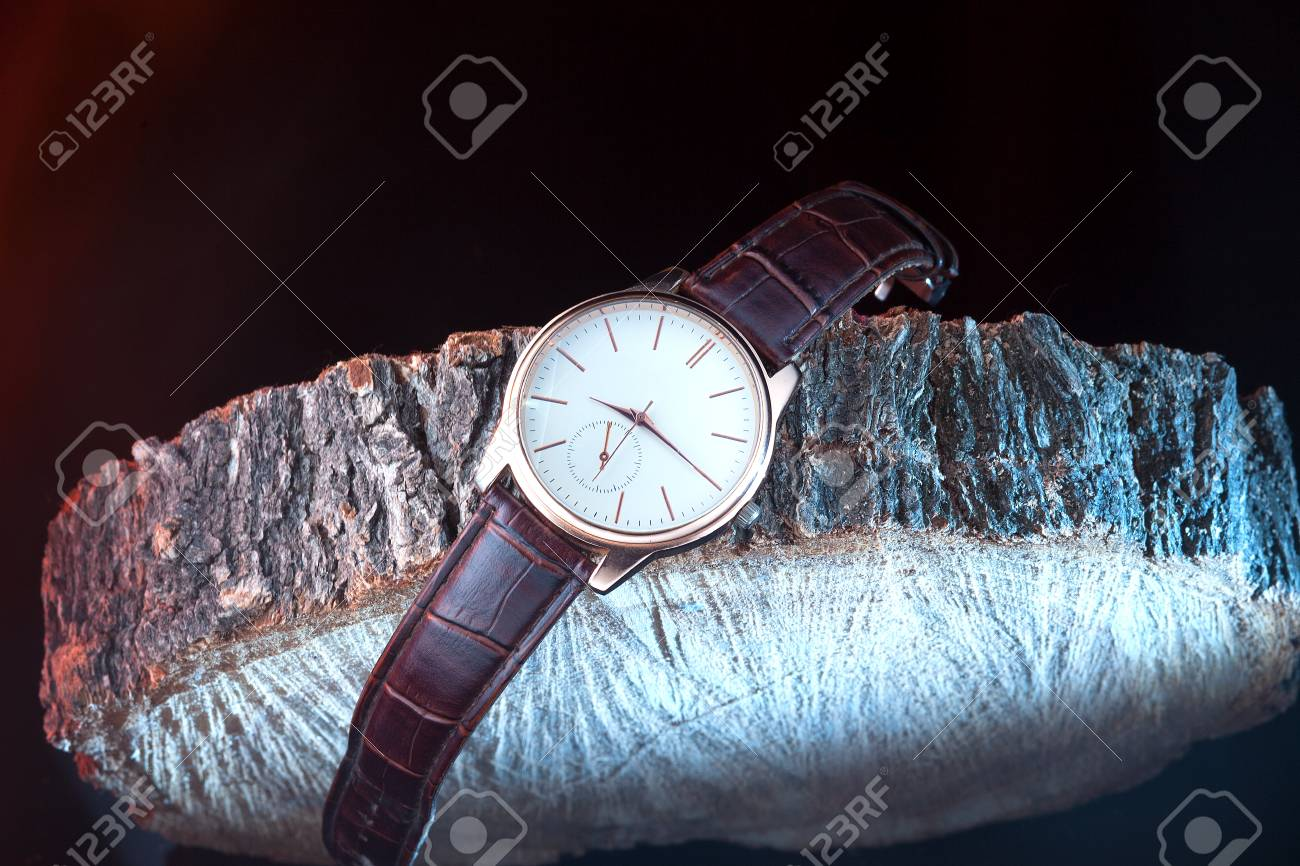Beautiful Watch On The Stub On Dark Background Stock Photo 1300x866