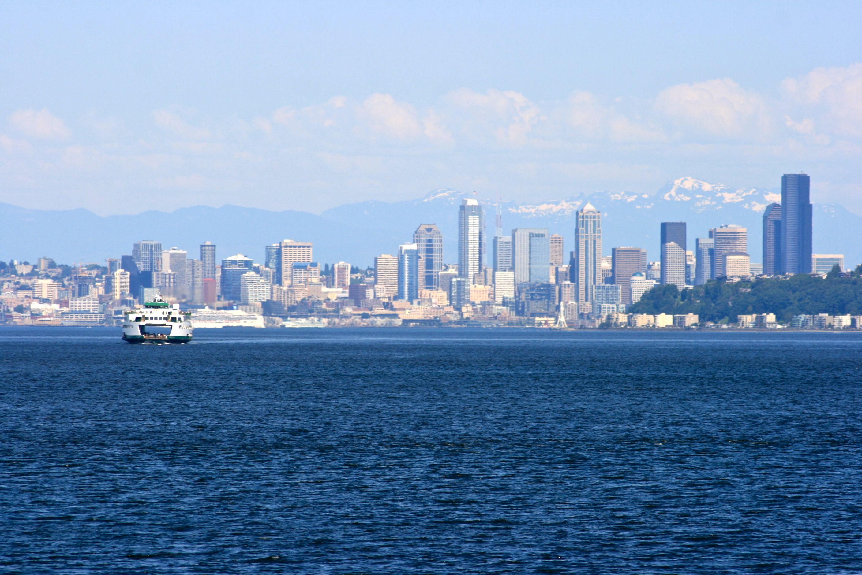 Seattle with the still snowcapped Cascade Mountains in the background 2816x1880