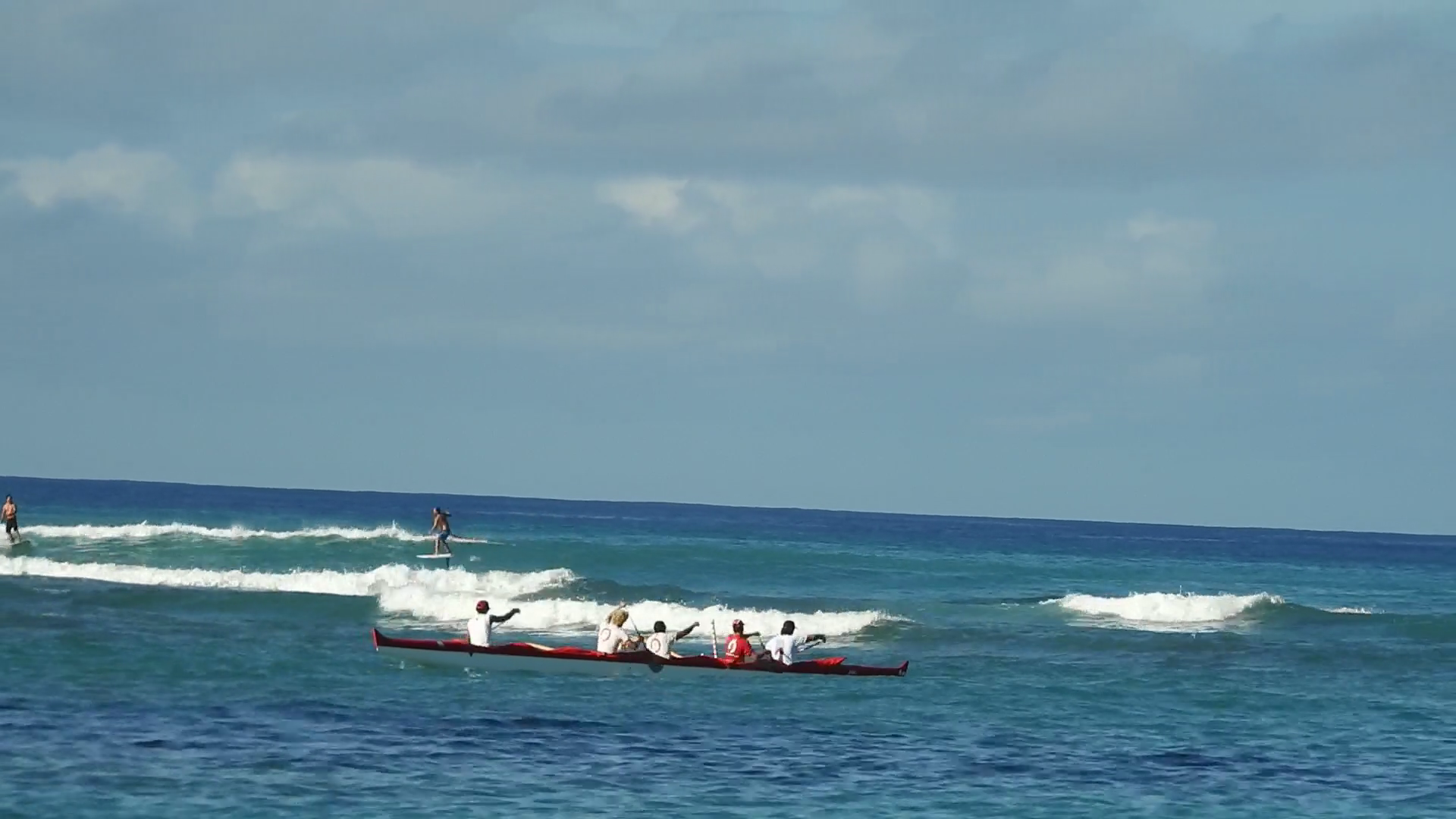 Canoes paddlers surfers and standup paddle boards at Kaimana 1920x1080