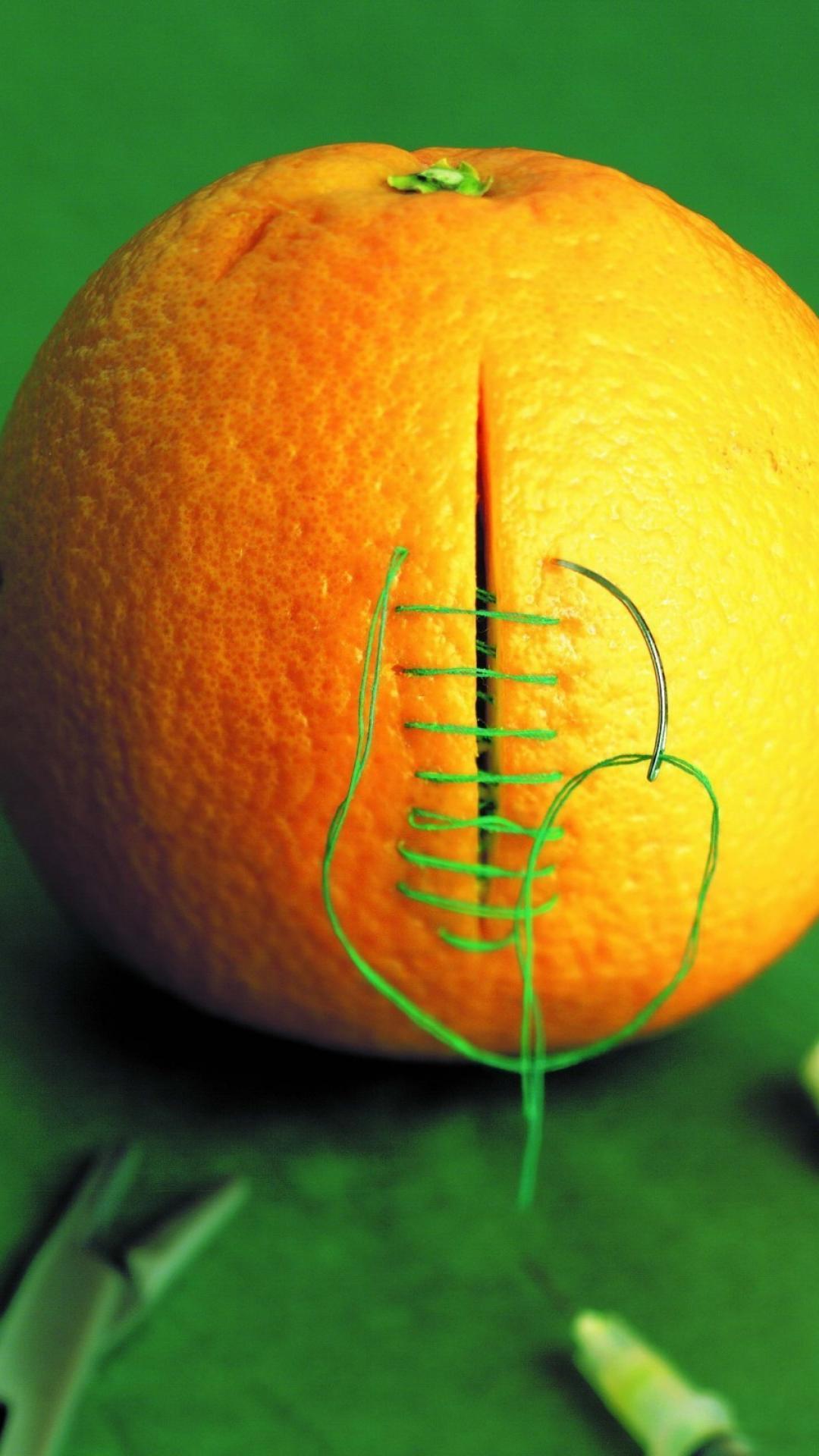 Orange funny medical stitch cutting green background wallpaper 1080x1920