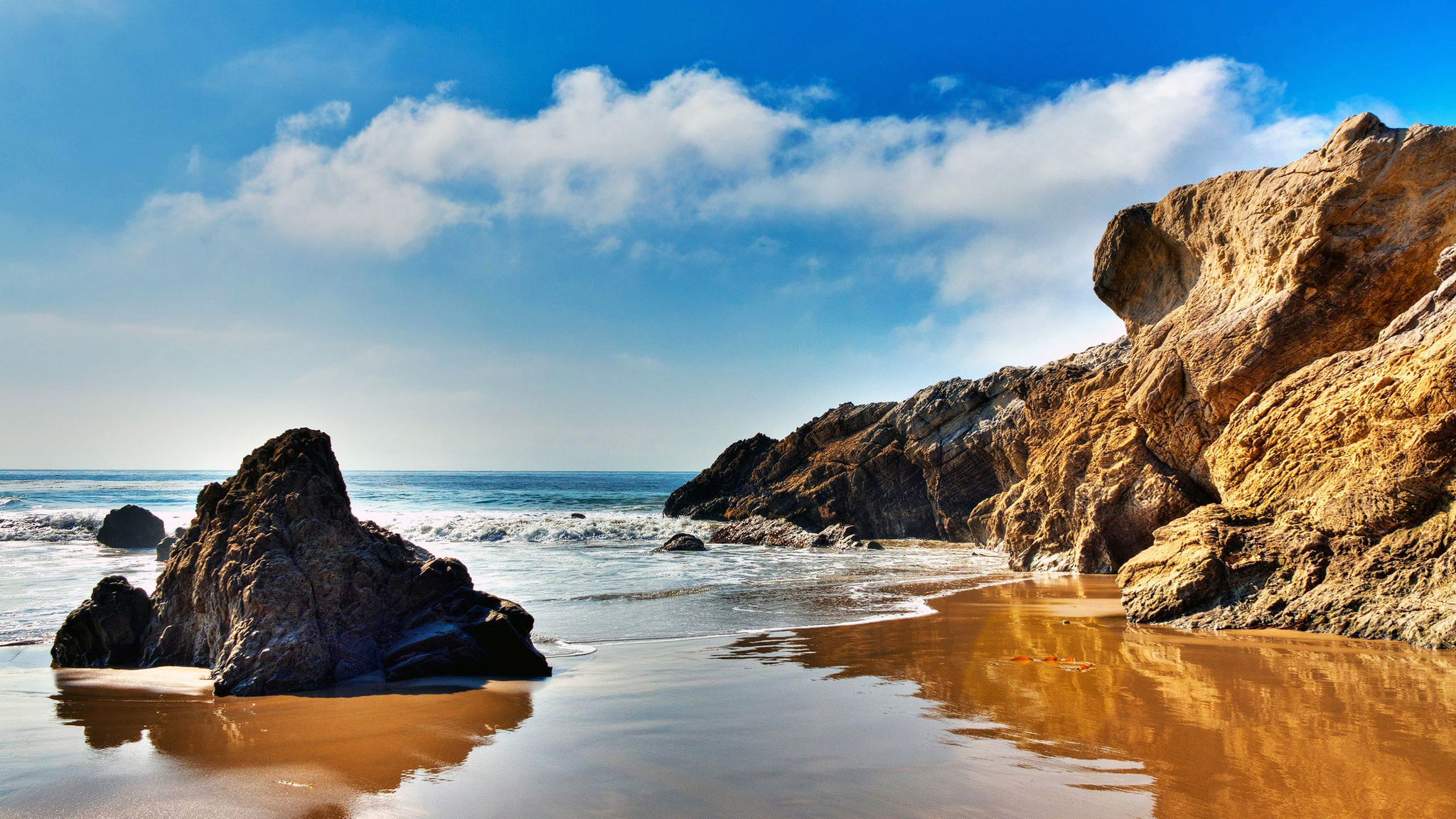 The wallpaper of beach at the Pacific Ocean in Malibu California 2048x1152
