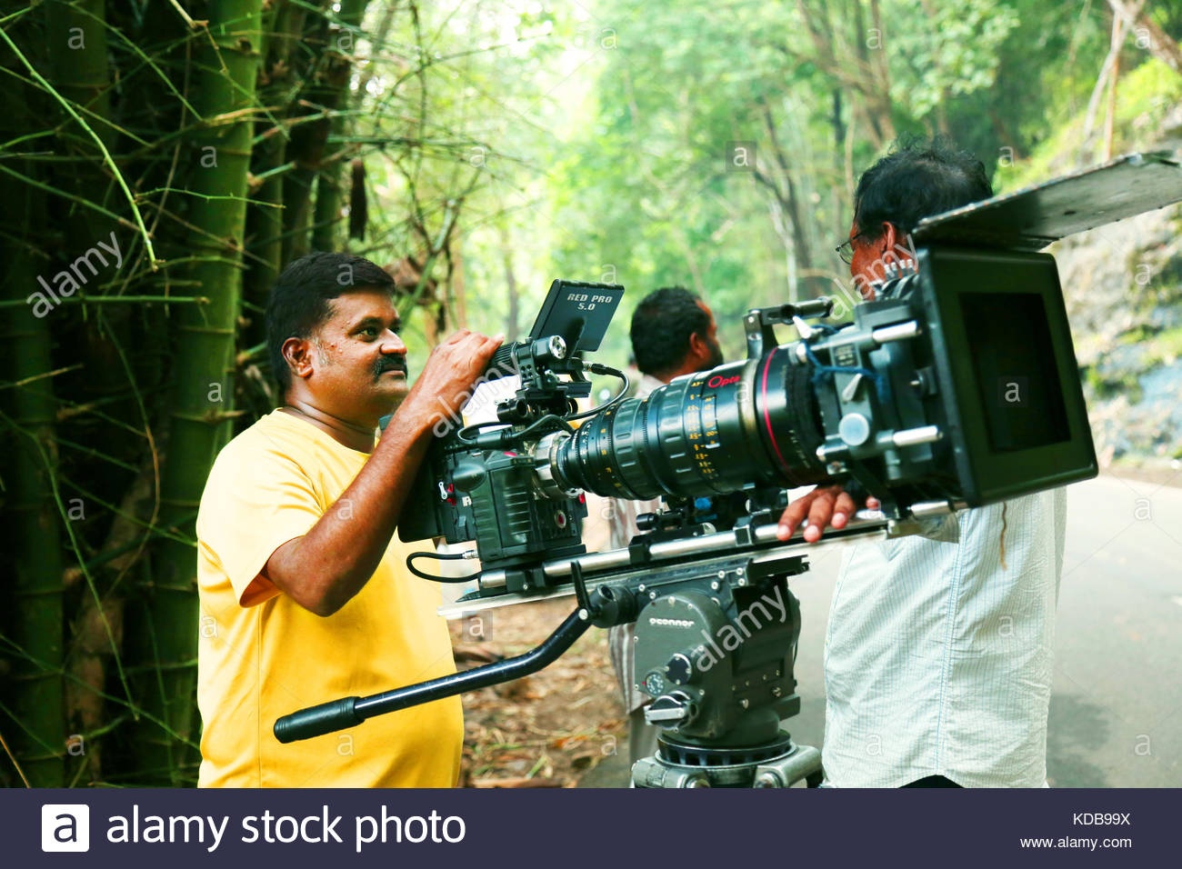 Video camera operator on nature background film shooting spot 1300x956