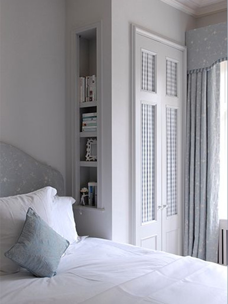Bedrooms Dress up closet doors with fabric wallpaper or moulding 450x598