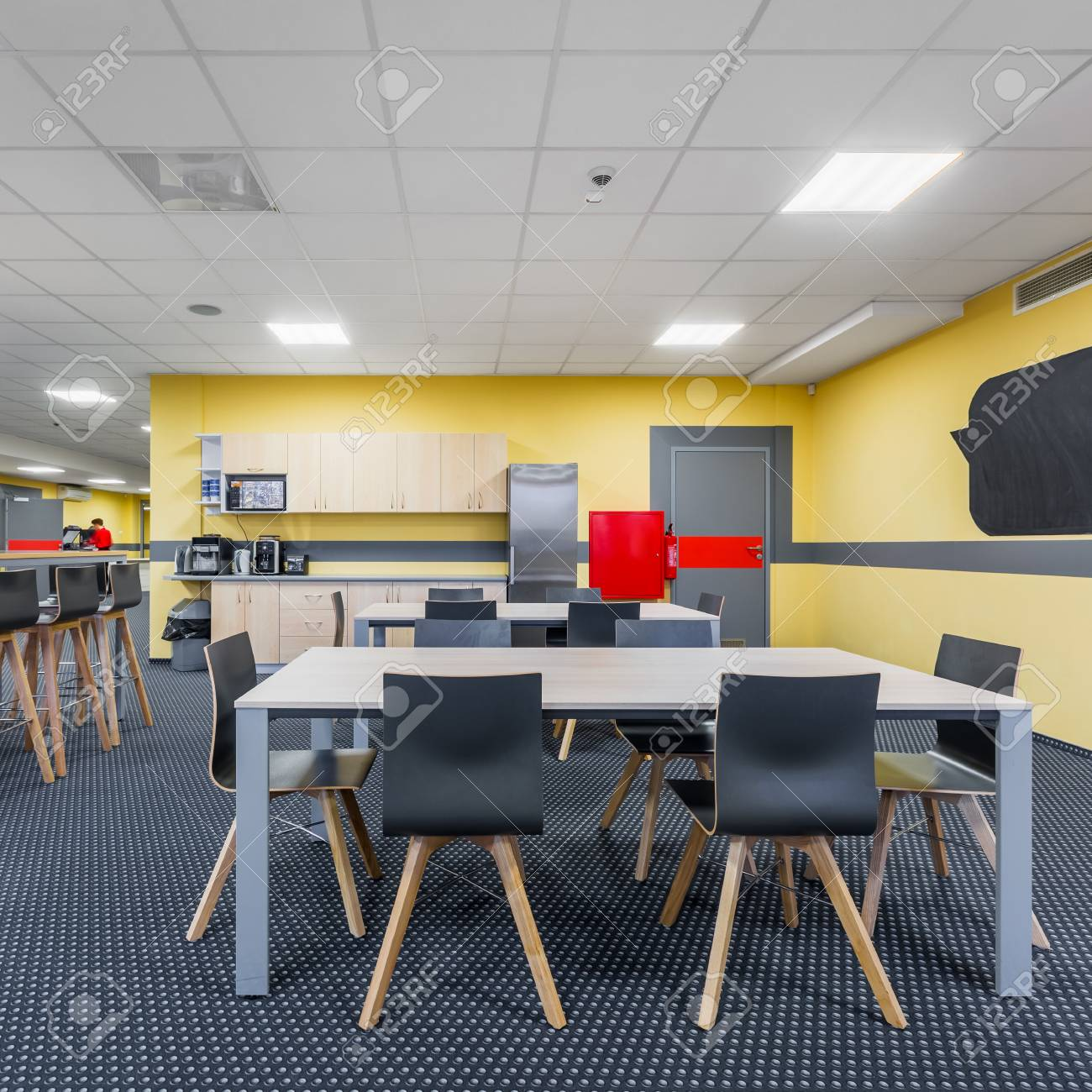 Modern Lunchroom Interior With Wooden Tables And Black Chairs 1300x1300