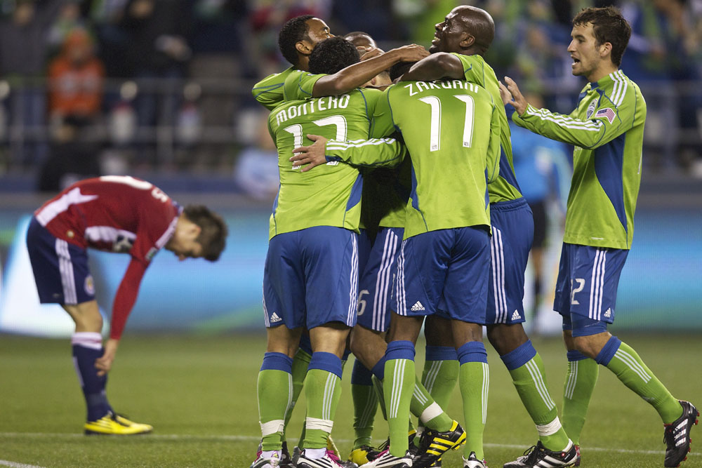 Seattle Sounders FC players including Blaise Nkufo, second from right ...