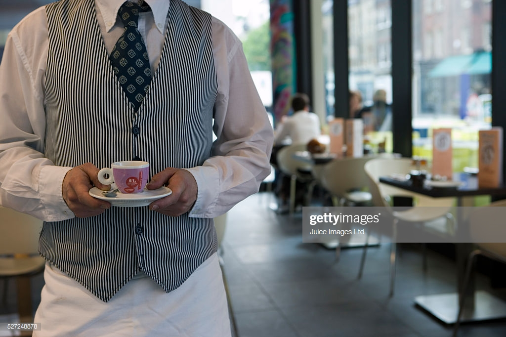 Waiter Holding Expresso Cup In Cafe Midsection Customers In 1024x682