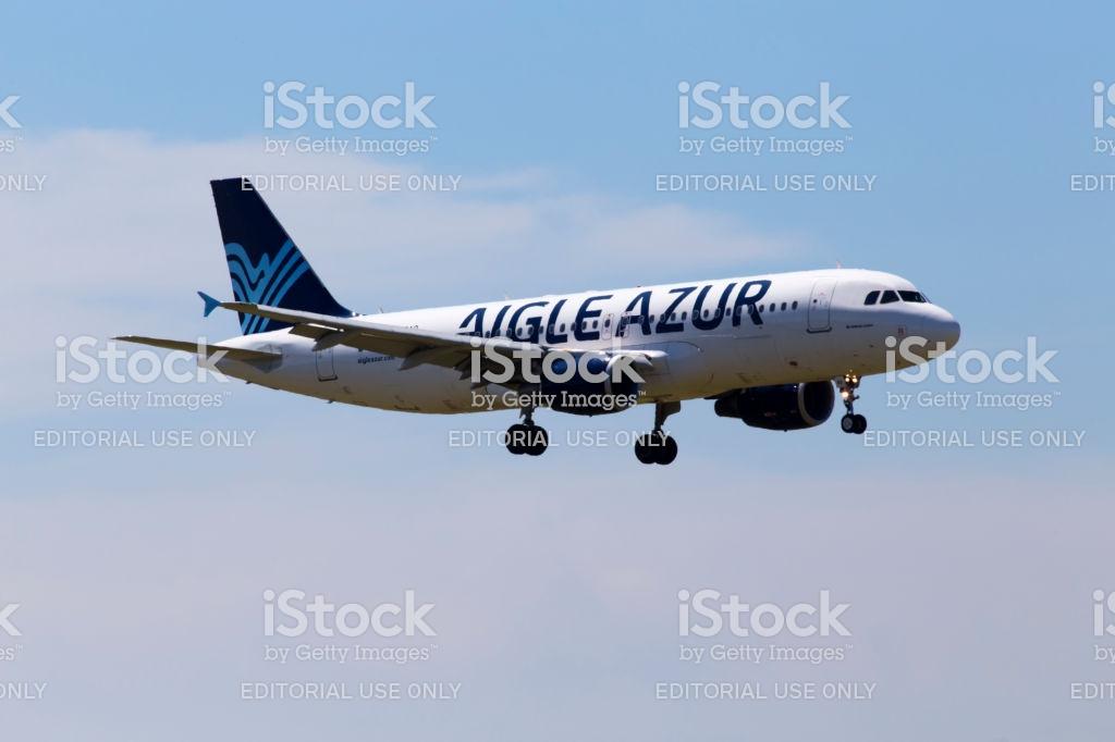 Fhbao Aigle Azur Airbus A320200 Aircraft On The Cloudy Sky 1024x682