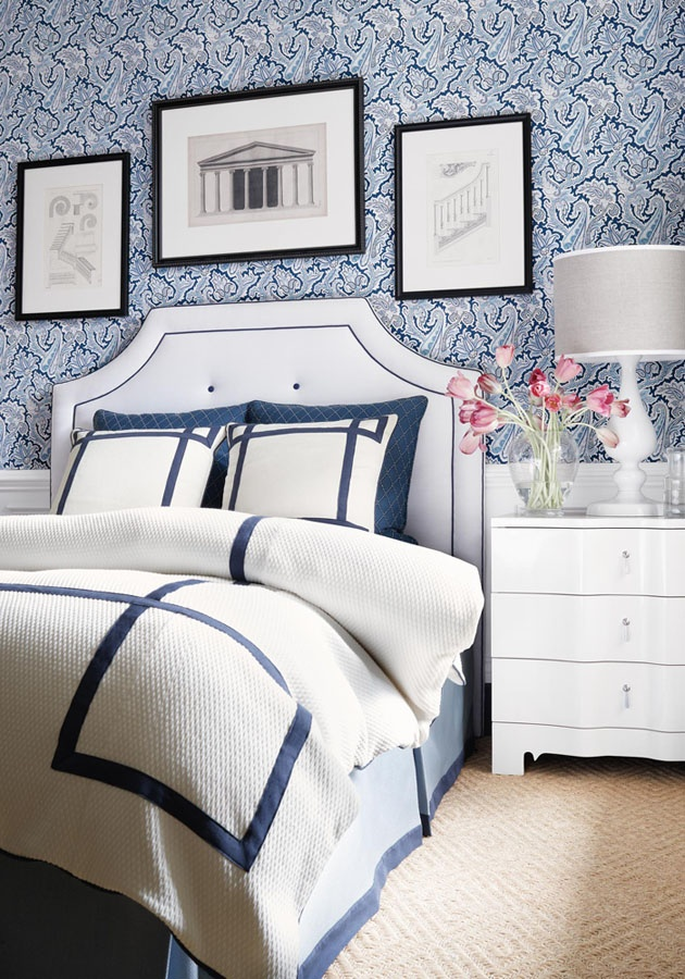 Paisley wallpaper in navy and a white matelasse duvet cover with navy 630x900