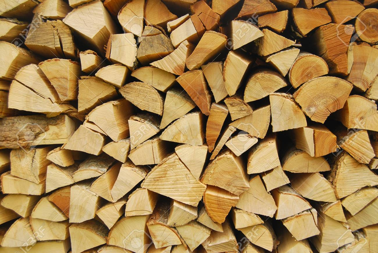 Firewood Stacked For Winter   Firewood Background Stock Photo 1300x870