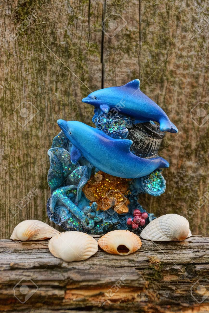 Corral Dolphins And Seashells On A Background Of Old Wood Stock 868x1300
