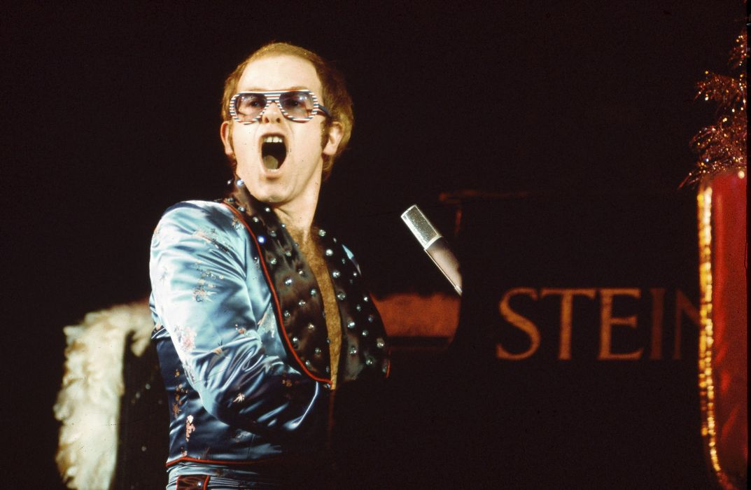 ELTON JOHN rock pop glam classic piano concert wallpaper 1073x700