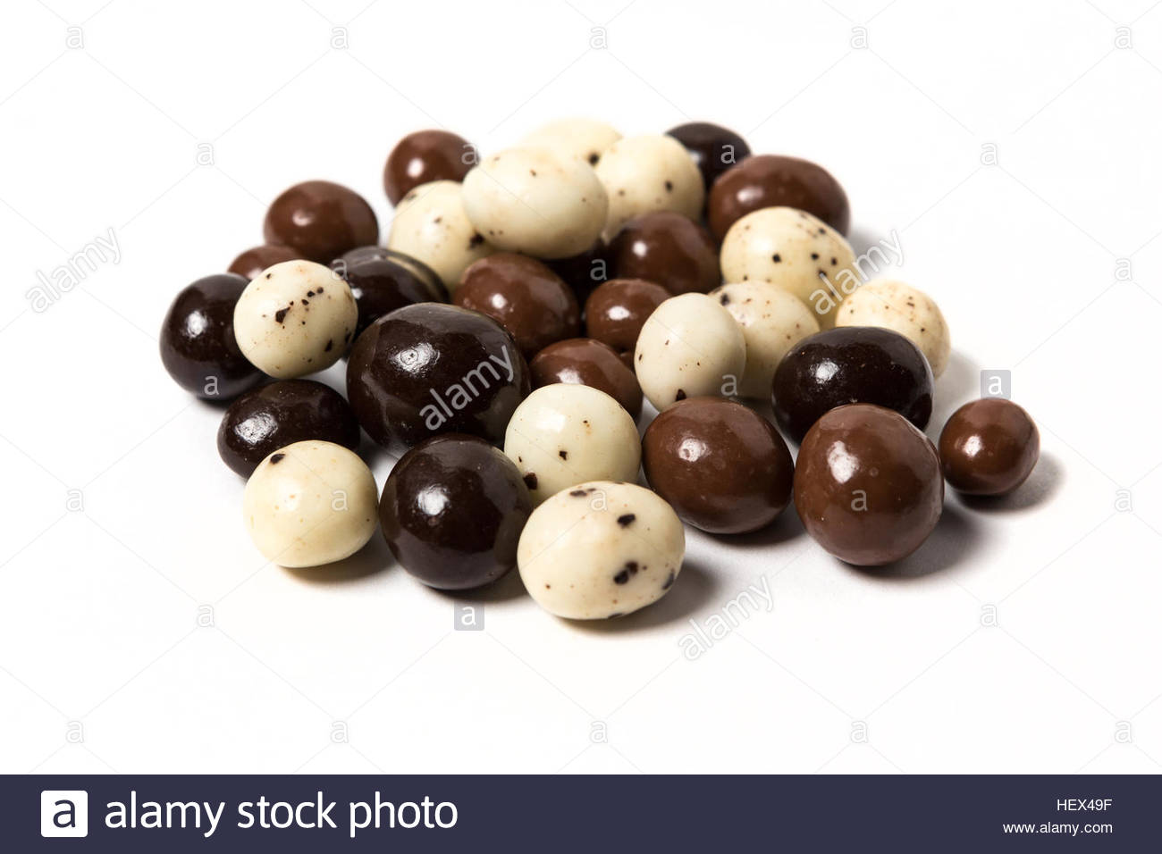 Chocolate expresso beans isolated on white background Stock Photo 1300x956