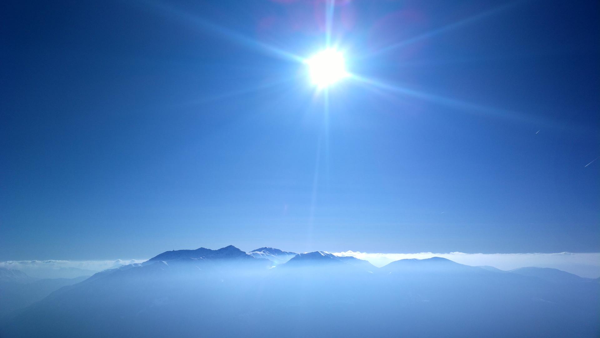 Sunlight Clouds Mountain Blue sky haze wallpaper background 1920x1080