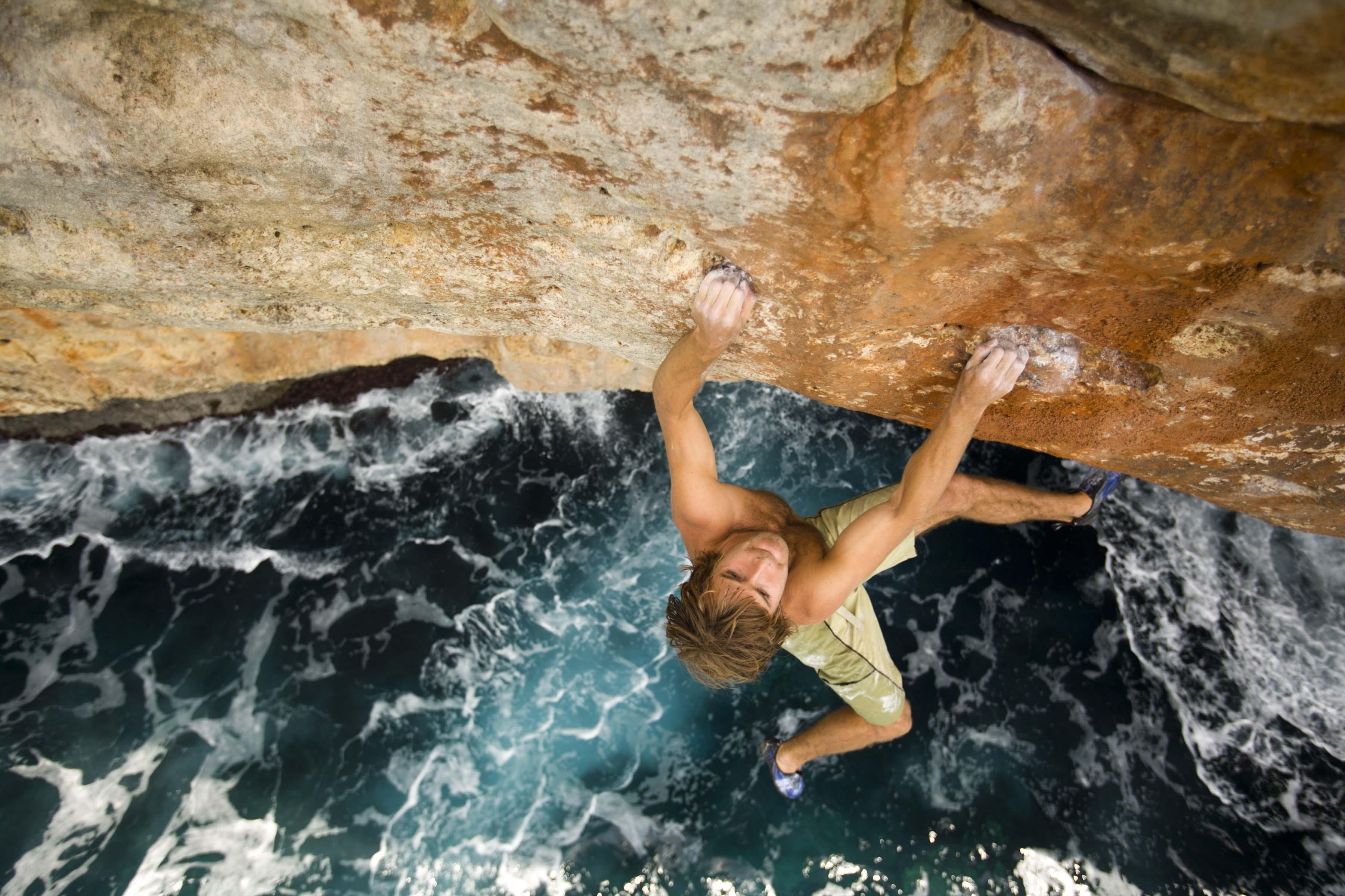Chris Sharma rock climbing deep water soloing in Mallorca Spain 3601x2400