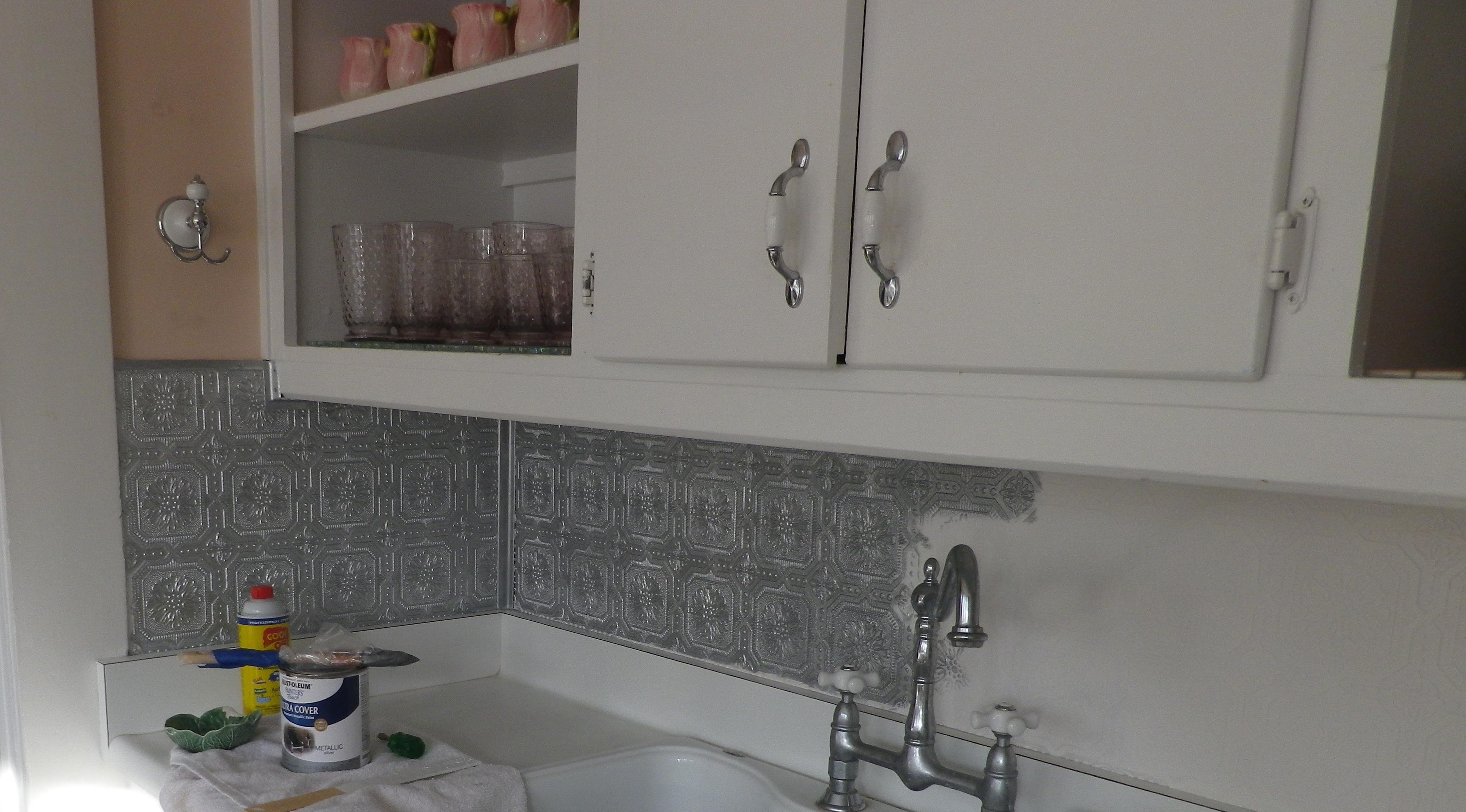Silver paint on the embossed wallpaper backsplash 4150x2300