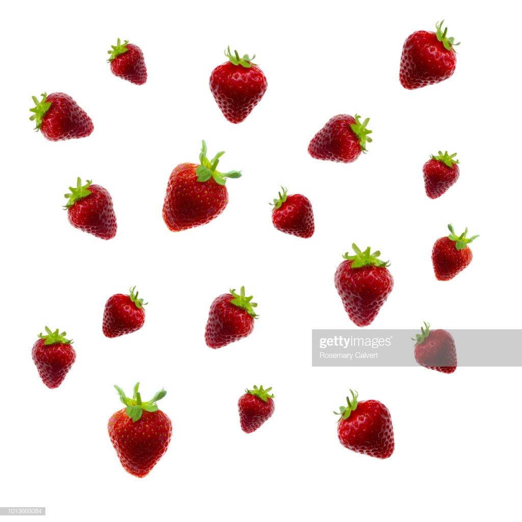 Tumbling Strawberries Create Background On White Stock Photo 1024x1024