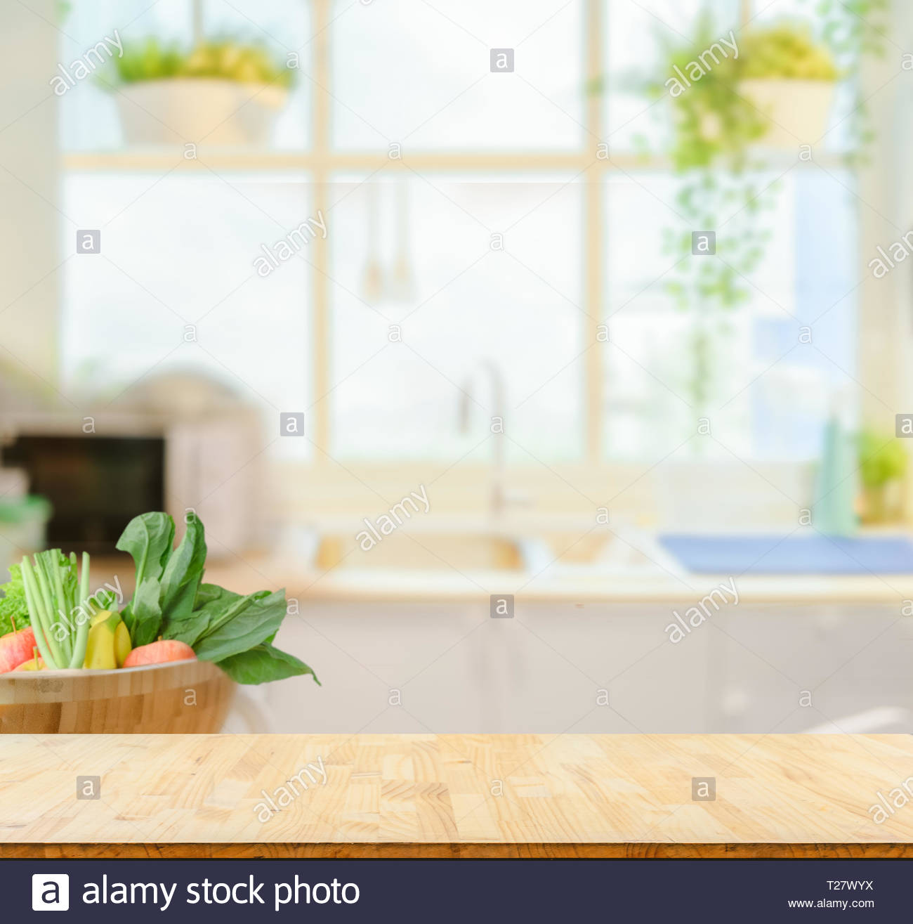 Wood table top on blurred kitchen background Stock Photo   Alamy 1300x1315