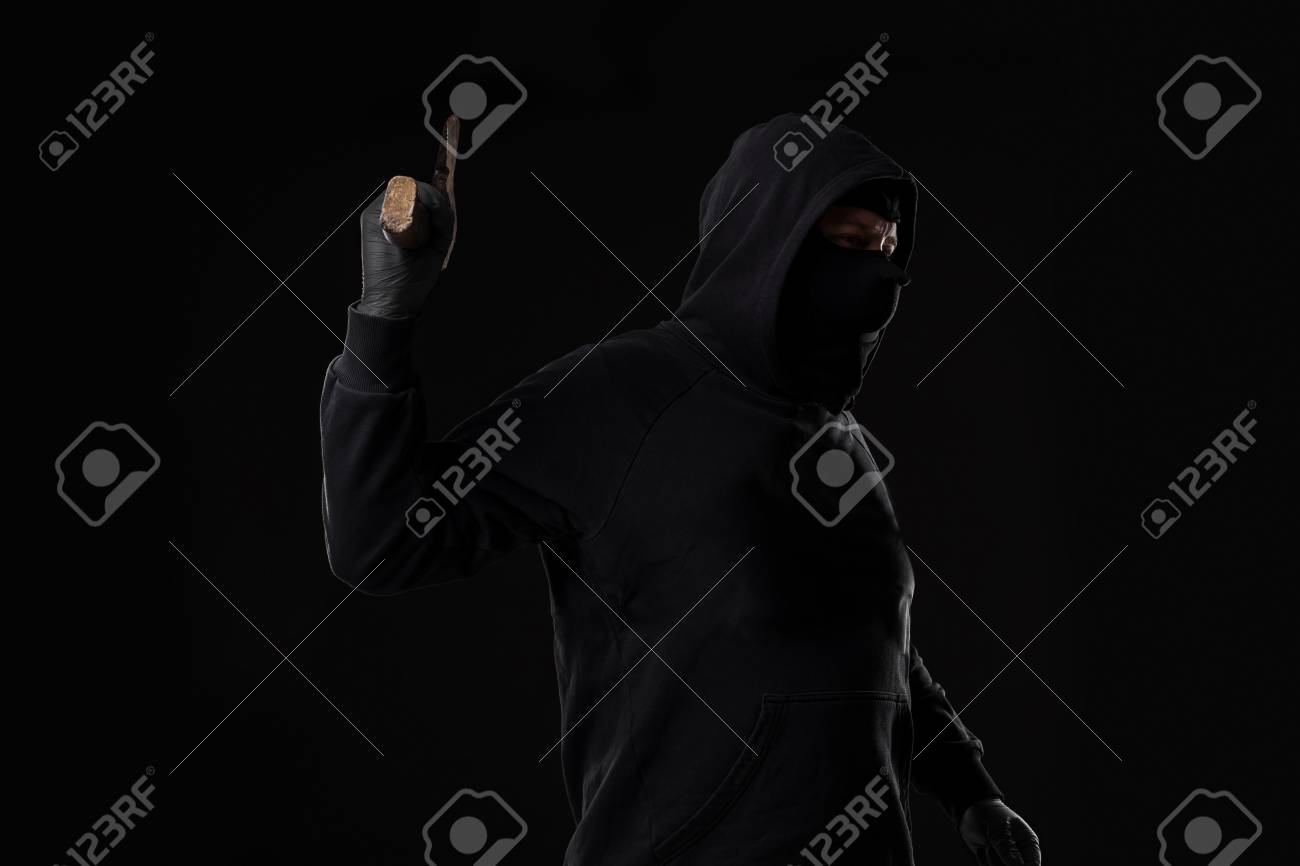 Bandit In Black Mask With Hatchet On Black Background Stock Photo 1300x866