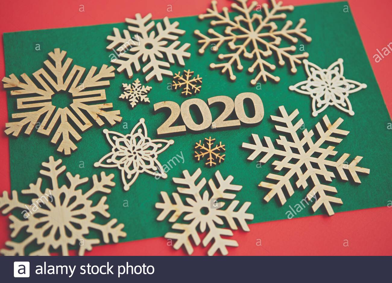 2020 winter holidays backgroundWooden snowflakes and figures on 1300x939