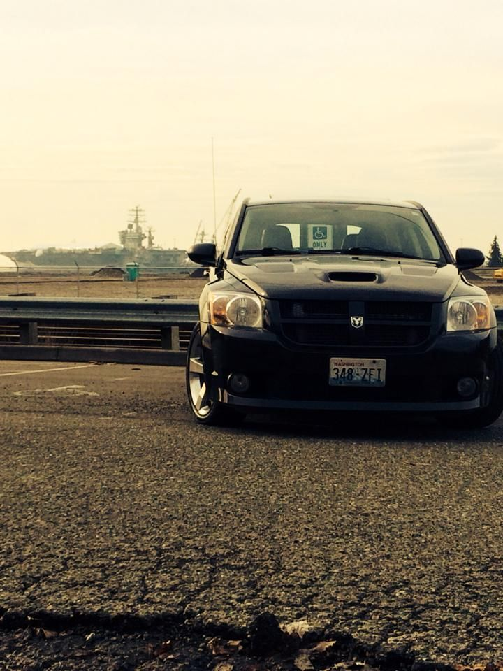 08 Caliber SRT4 with USS Nimitz CVN68 in the background Cars 720x960