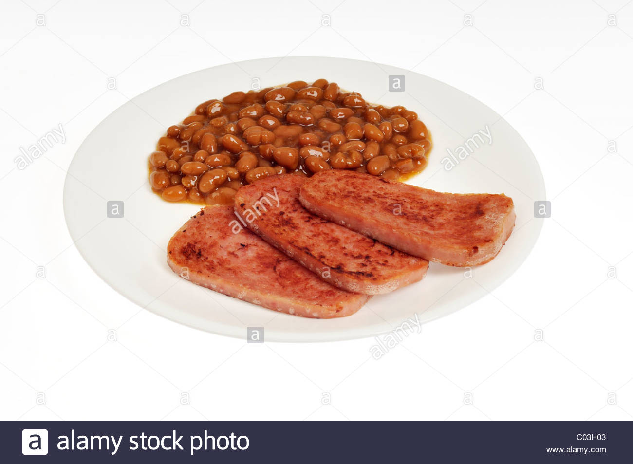 Cooked grilled Hormel spam with pork and beans on white plate with 1300x953
