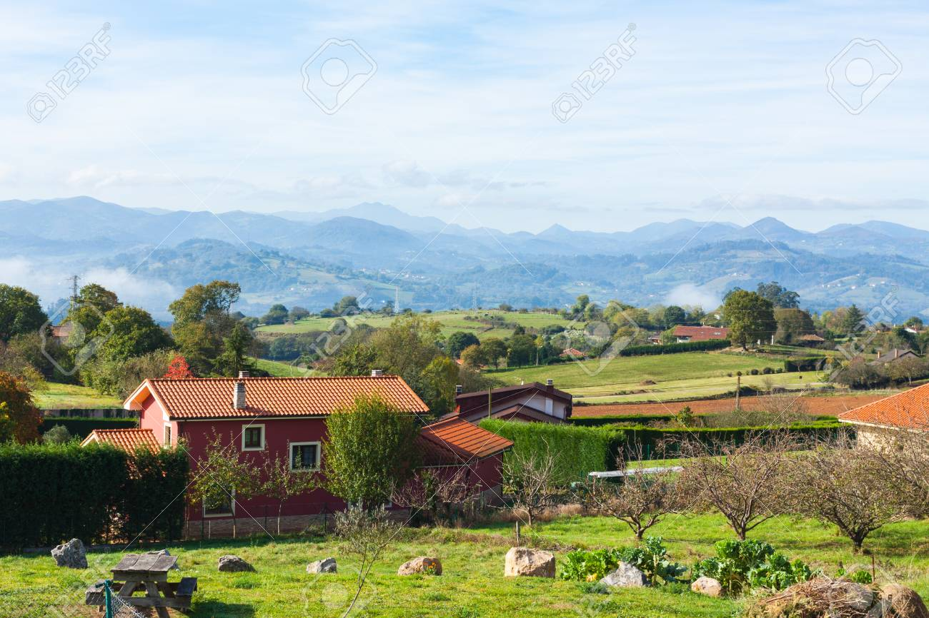 Pastoral Landscape Of Escamplero Village With Mountains In The 1300x866