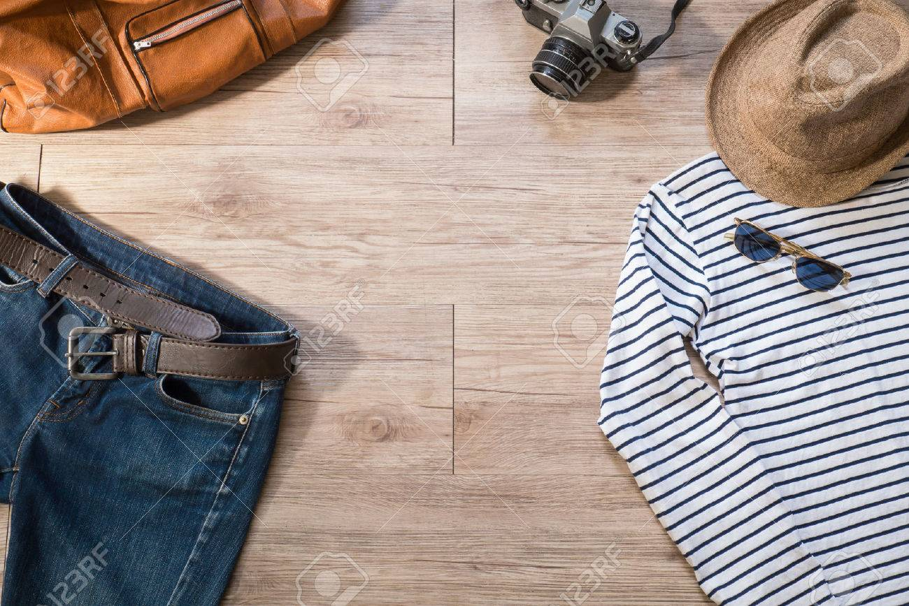 Top View Of Vintage Clothing And Accessories On The Wooden 1300x867