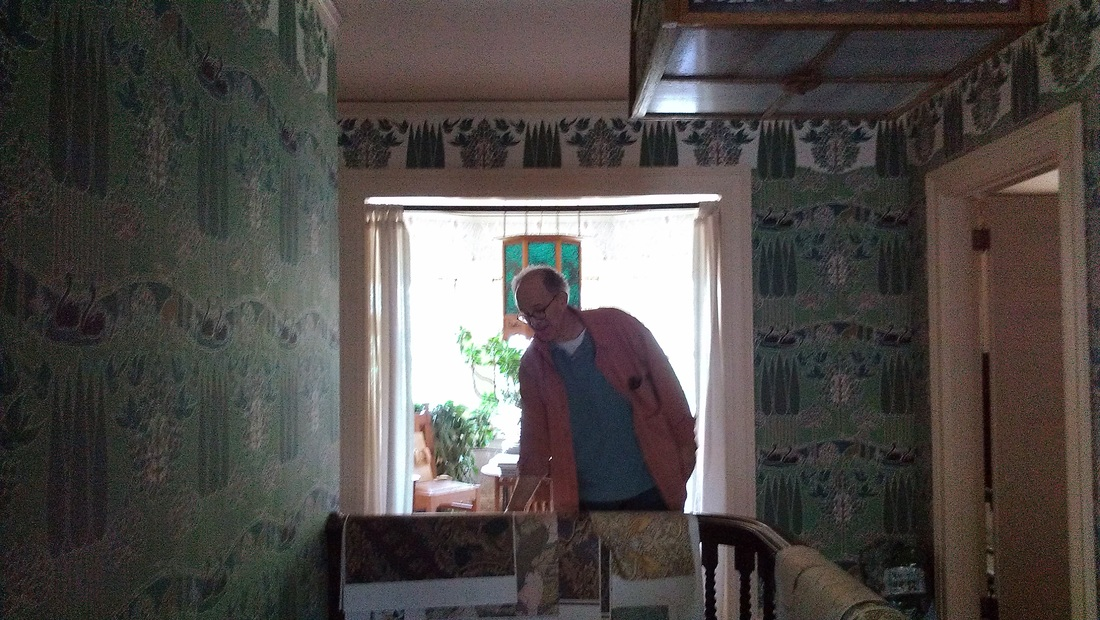 David Berman of Trustworth Studios in his beautifully wallpapered 1100x620