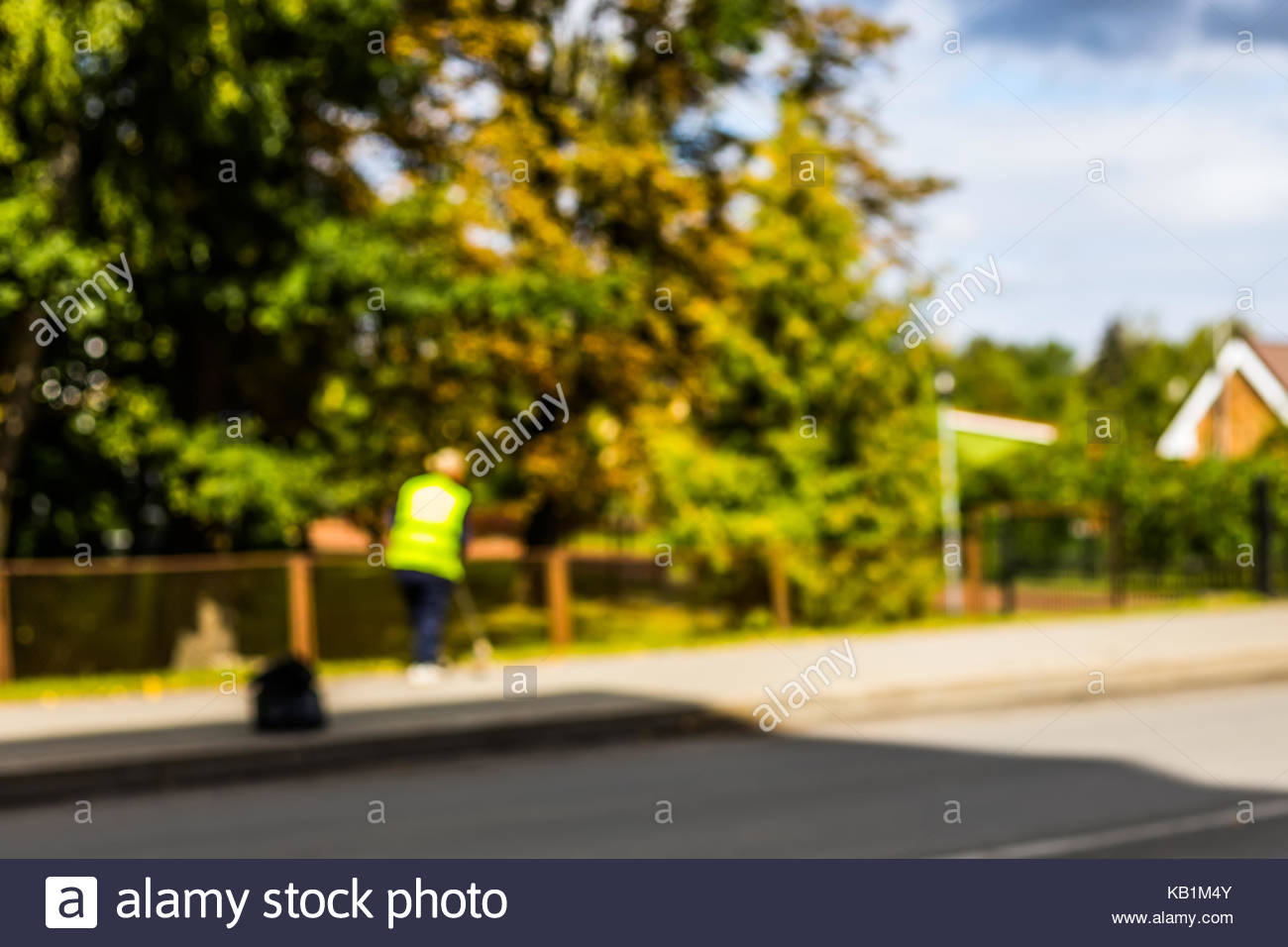 Abstract blurred background   road sweeper worker cleaning city 1300x956