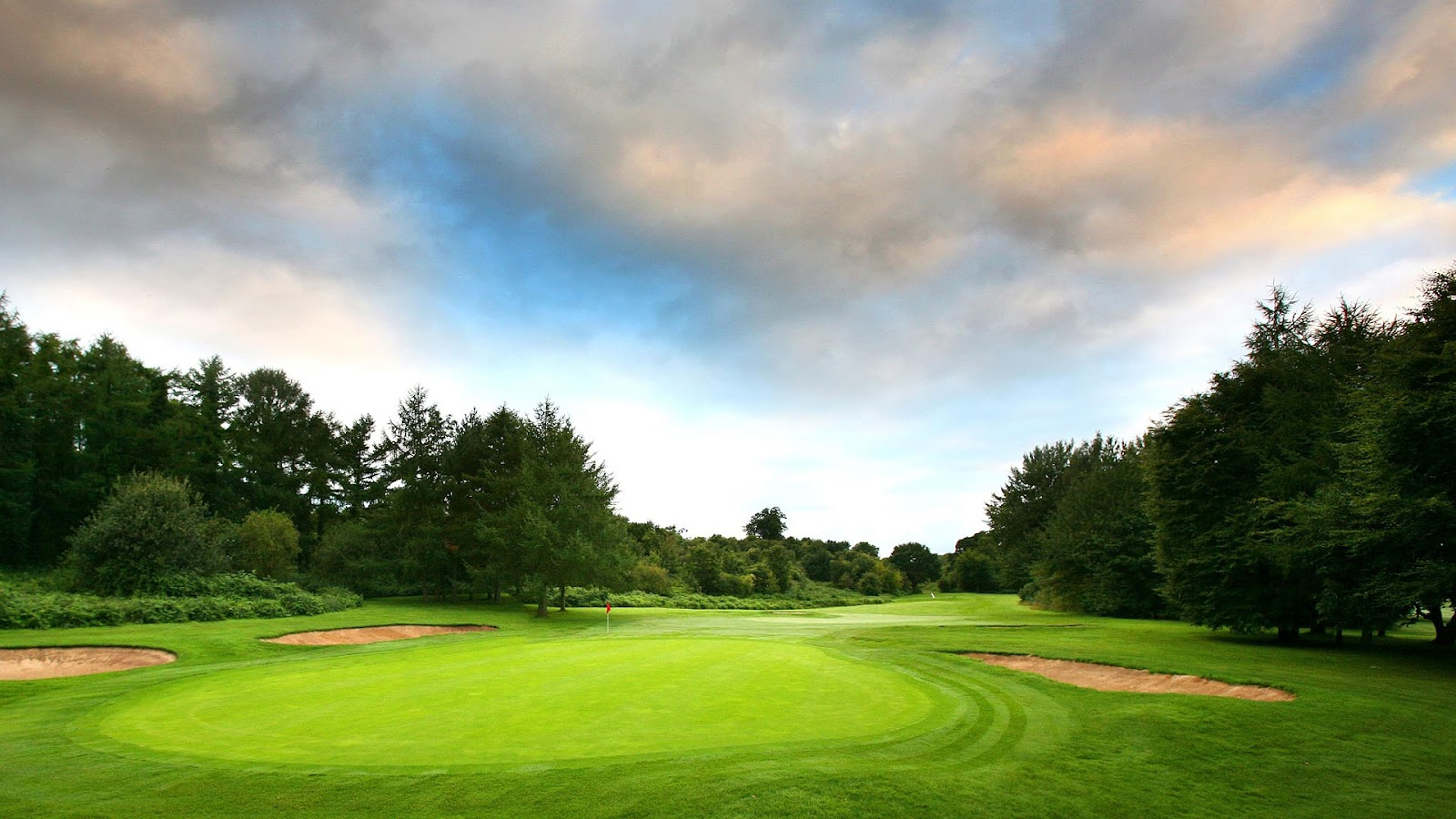 Golf background for computer with a golf course with sand and trees 1600x900