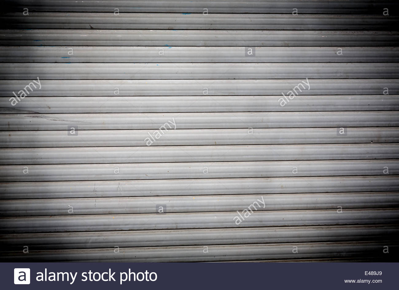 dirty old roller shutter for backgrounds with strong vignette 1300x948