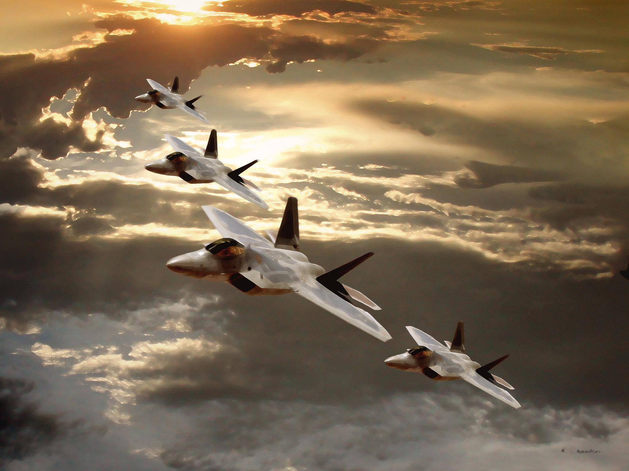 Four gray F 22 Raptor combat jet planes in formation flight in golden 2048x1536