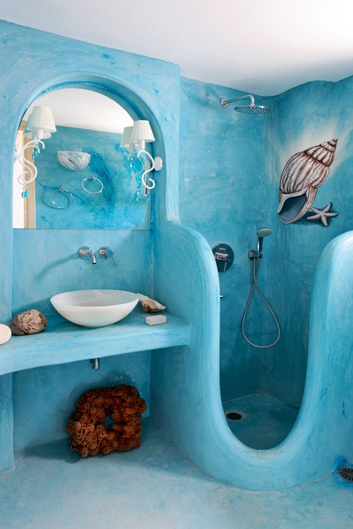 Funky wallpaper in blue and white with goldfish swimming about giving 500x750