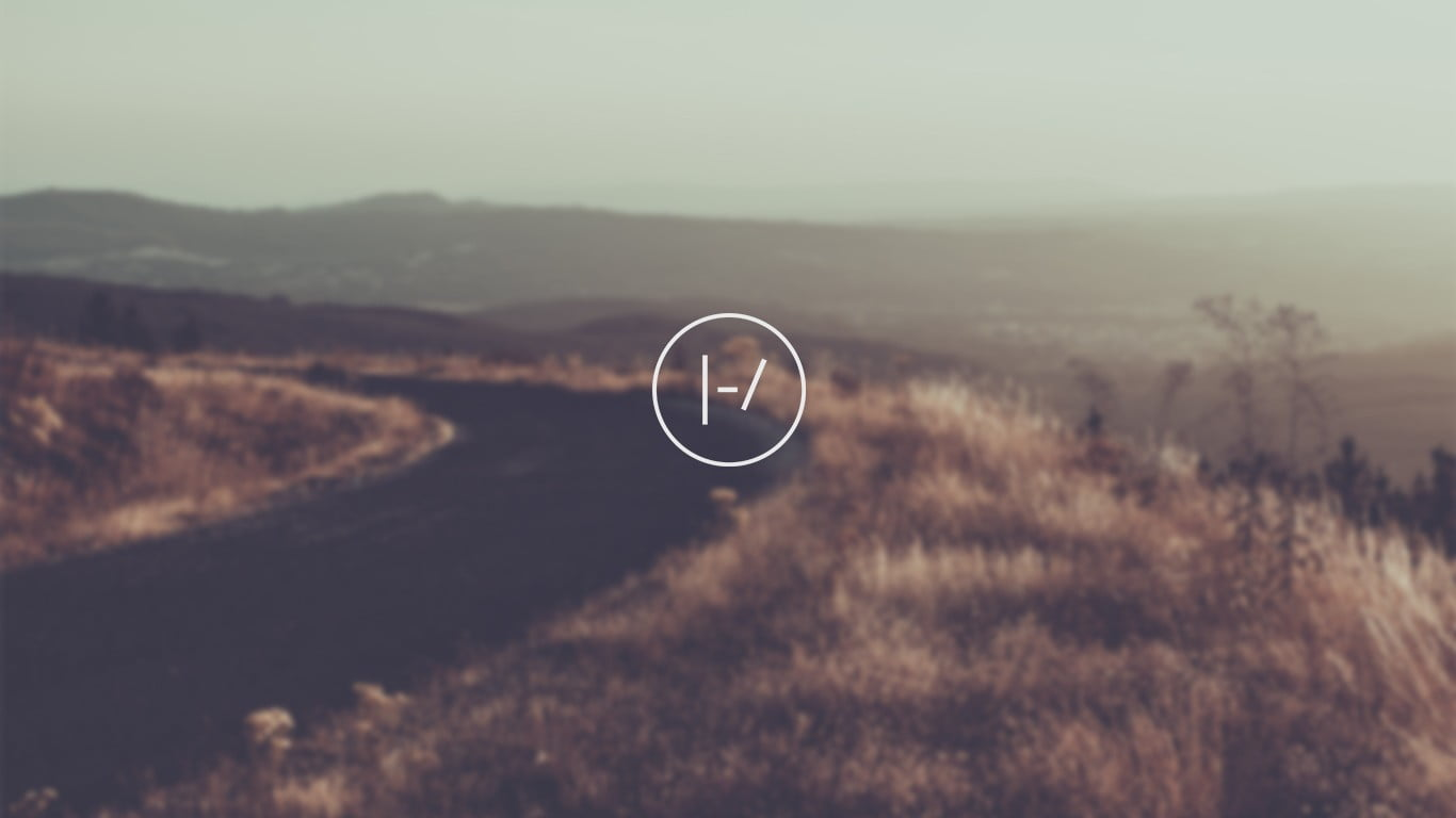 Curve road surrounded by grass Twenty One Pilots top HD 1366x768