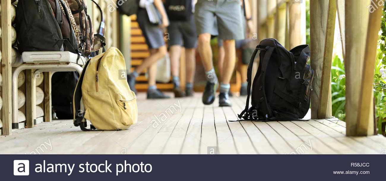 Students walking in background Backpacks and school bags sitting 1300x611