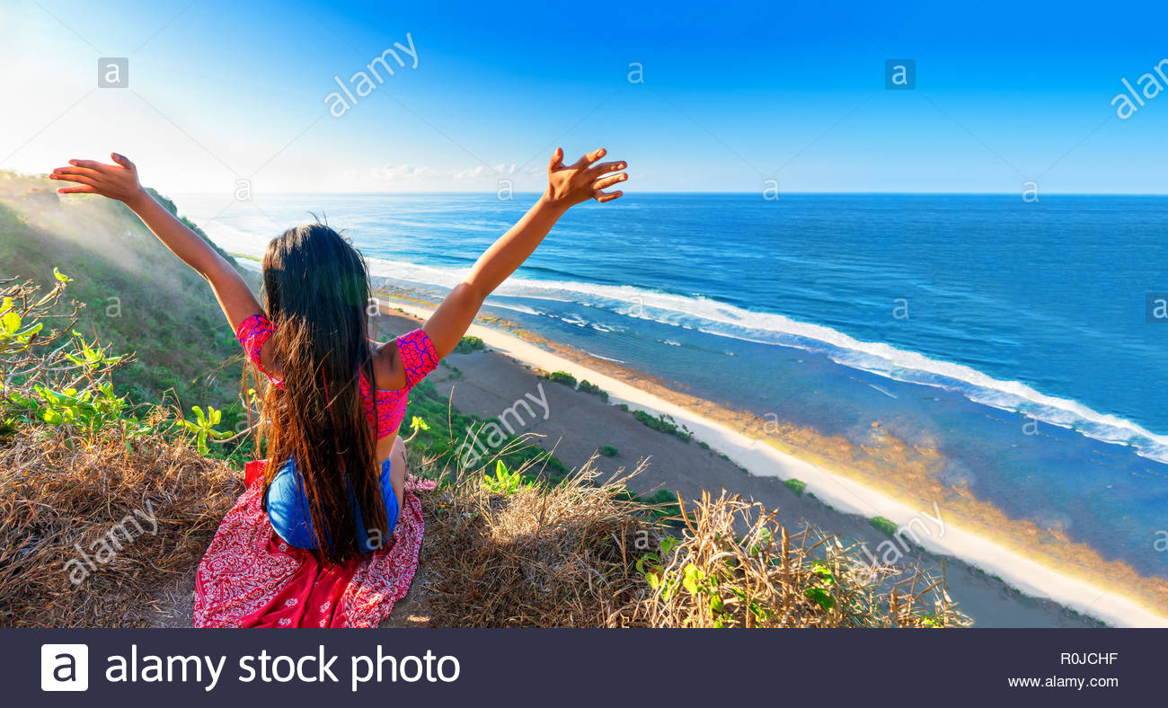 Happy travel girl enjoy vacation on top mountain cliff on 1300x788