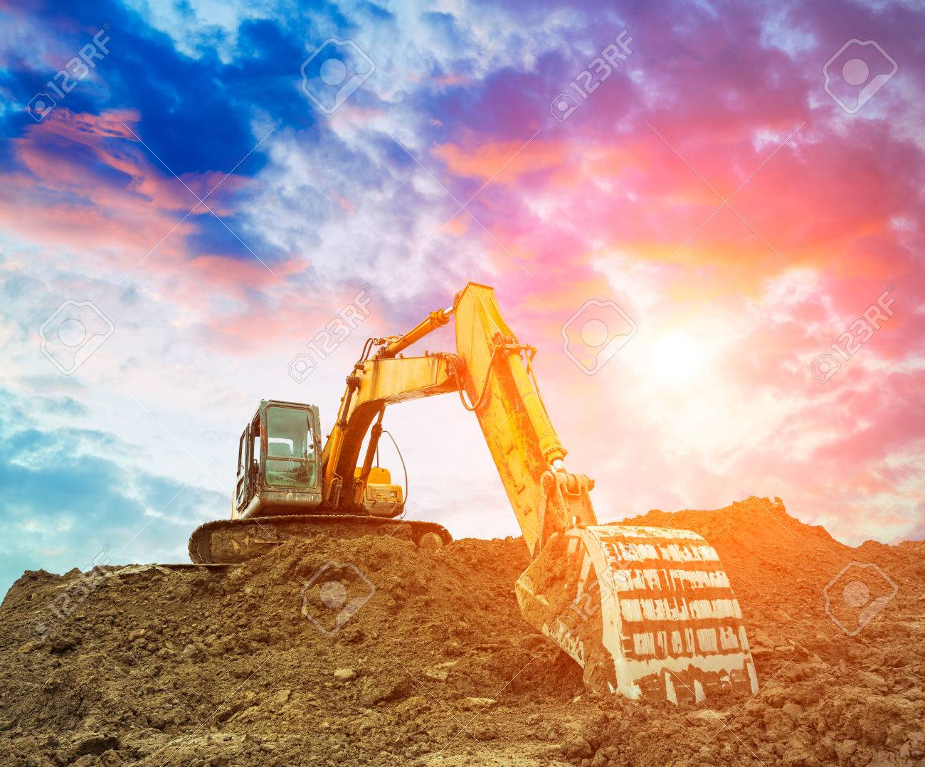 Free Excavator In Construction Site Sunset Sky
