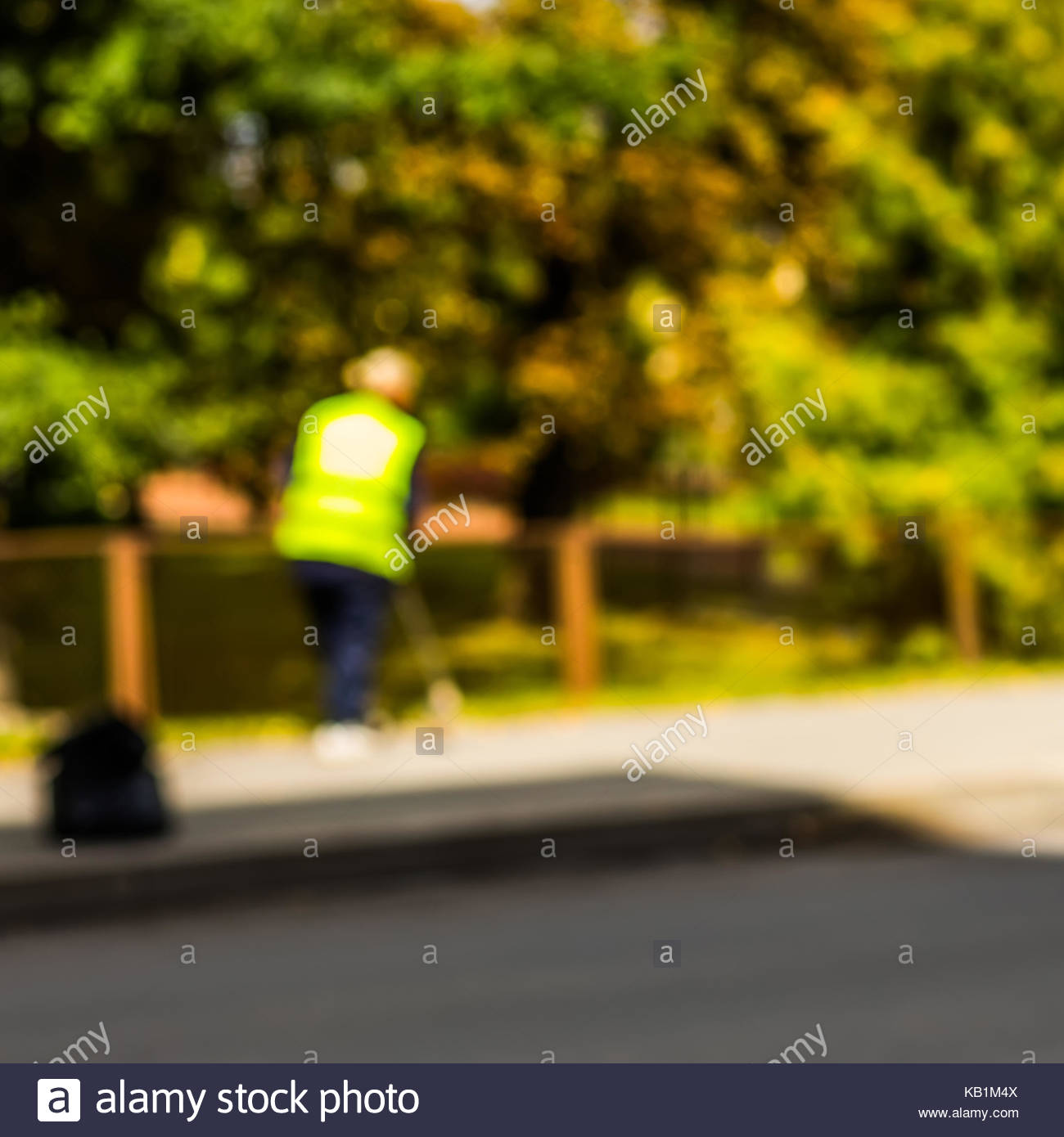 Abstract blurred background   road sweeper worker cleaning city 1300x1390