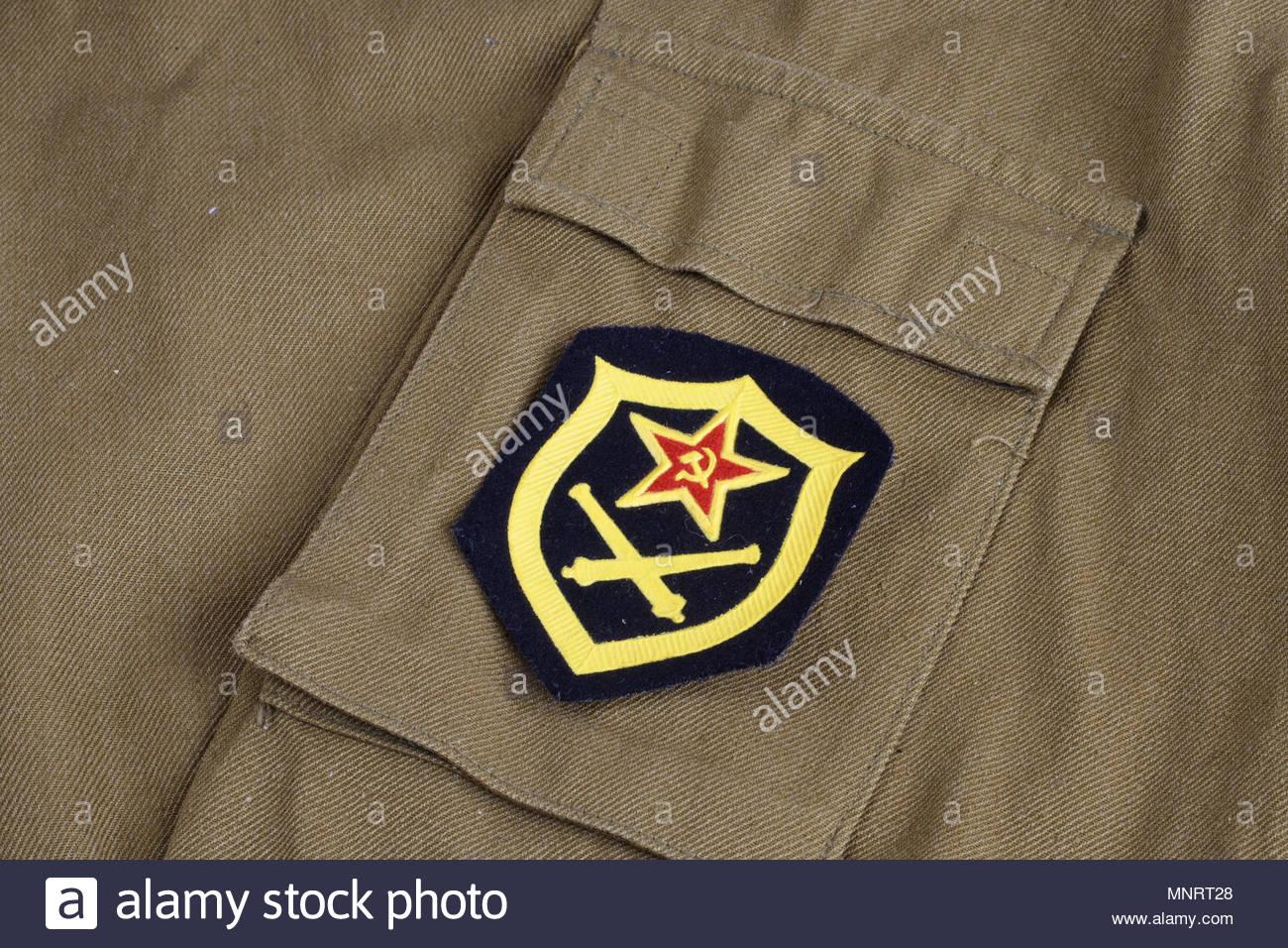 Soviet Army Artillery shoulder patch on khaki uniform background 1300x956