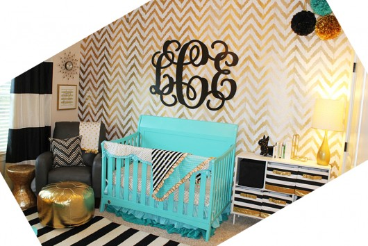 gold stenciled accent wall in a nursery using the Ikat Zig Zag 530x354