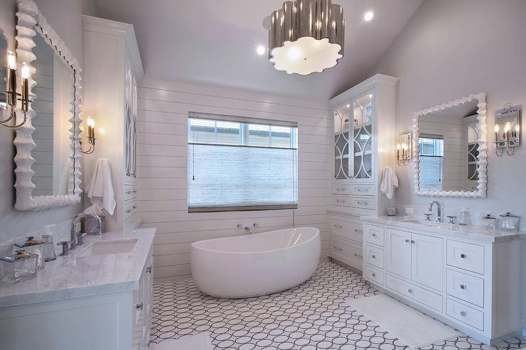 White and gray bathroom features a shiplap clad accent wall lined with 740x493
