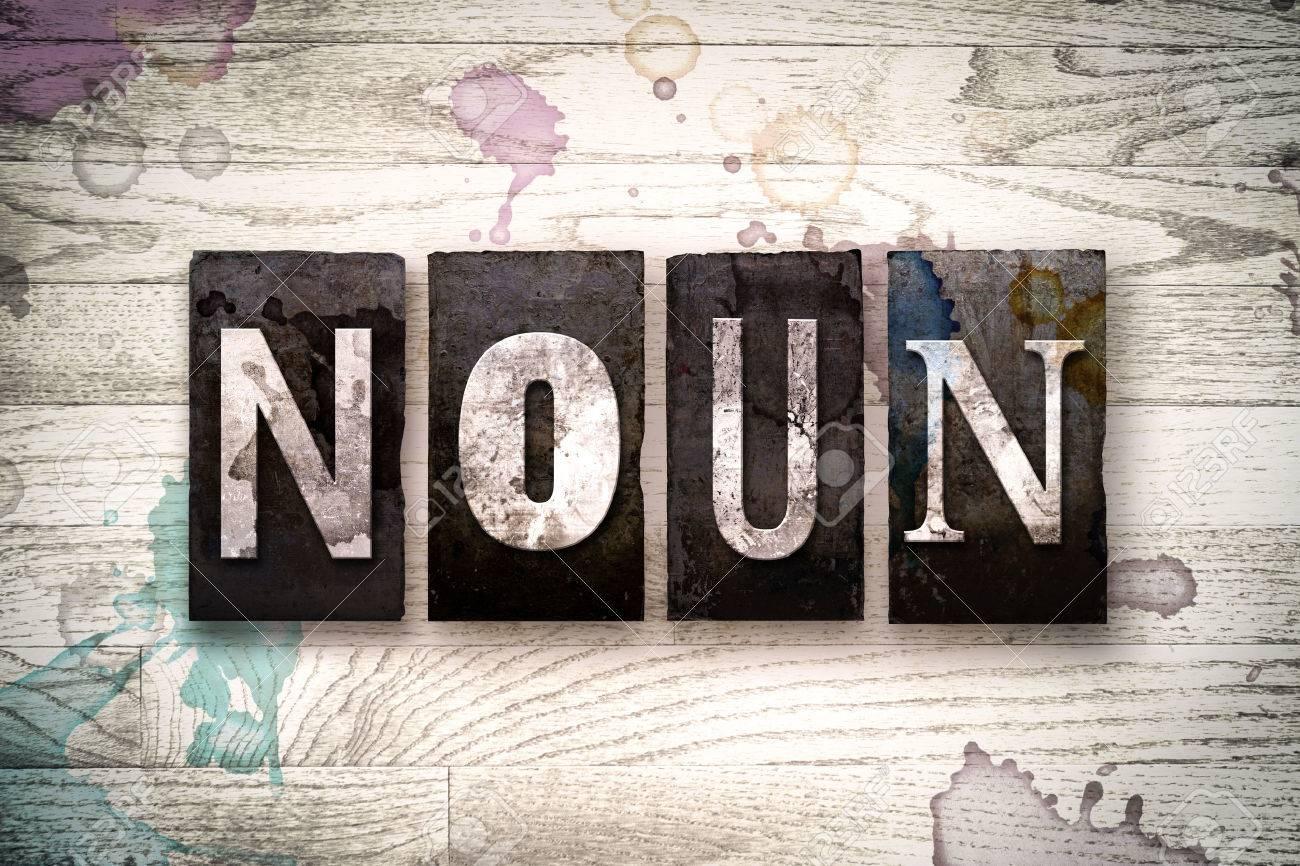 The Word NOUN Written In Vintage Dirty Metal Letterpress Type 1300x866