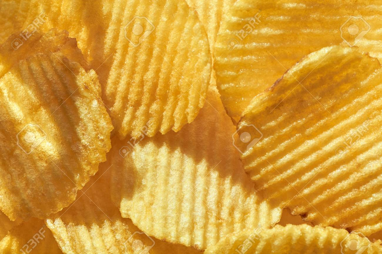 Food Background Of Corrugated Delicious Golden Crisp Potato Chips 1300x866