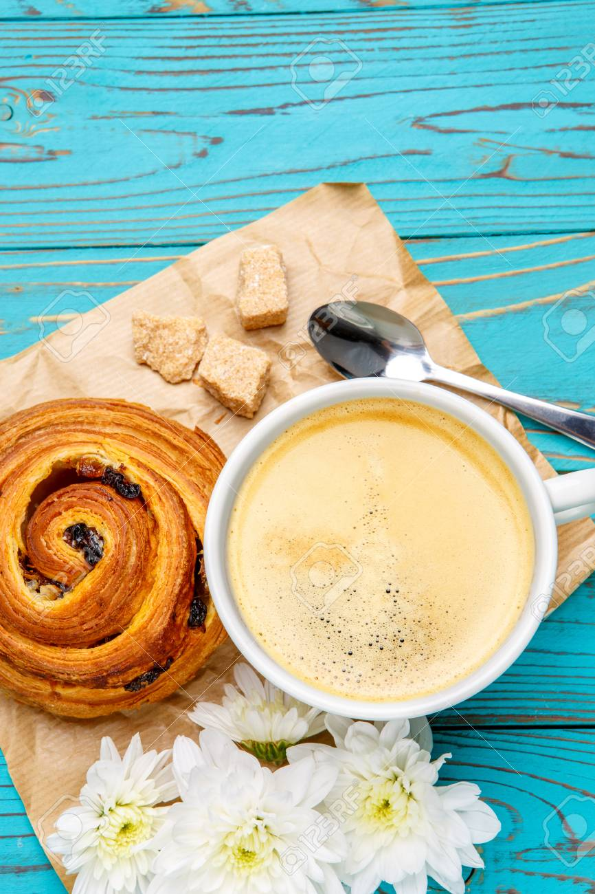Studio Shot Of Fresh Cinnabon And Coffee On Wooden Background 866x1300