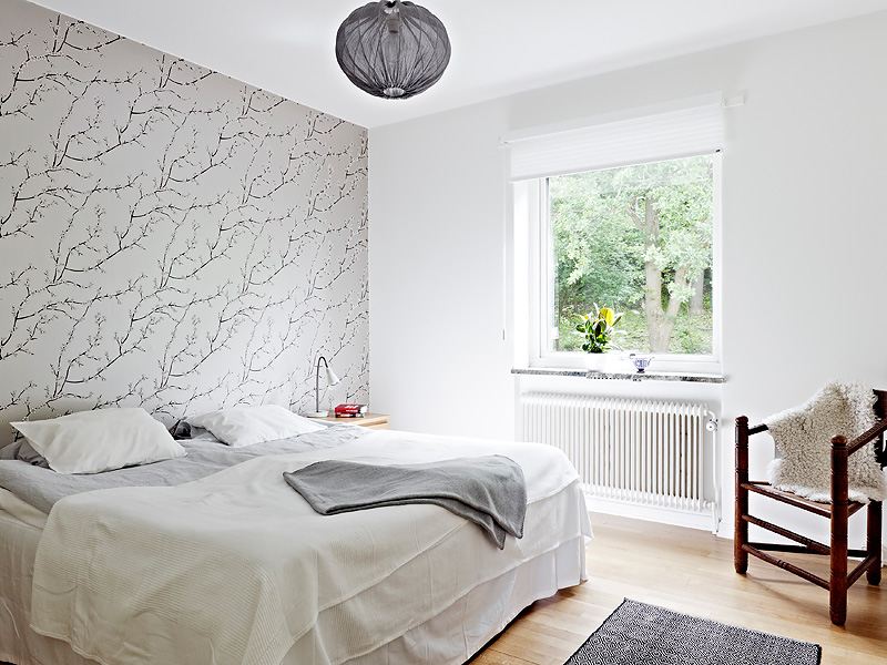 modern bedroom with one wall covered in gray wallpaper with branches 800x600