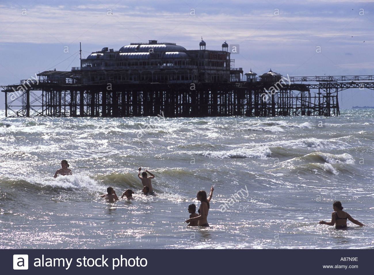 Brighton West Pier Seafront Young family playing in the sea with 1300x955