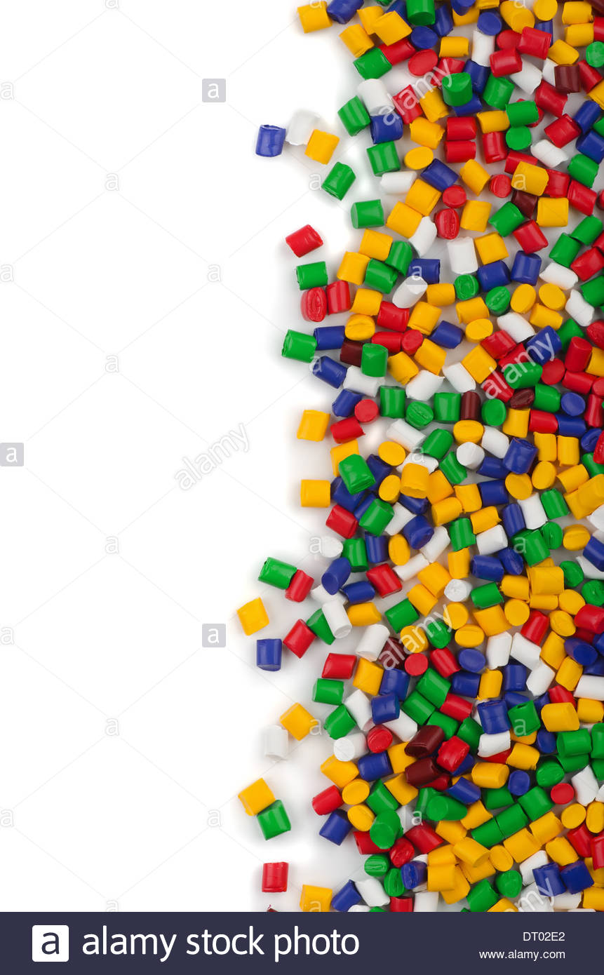 Colorful plastic polymer granules on white background Stock Photo 861x1390