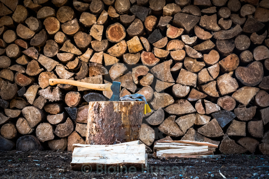Axe with work gloves split wood kindling with a stacked 1120x748