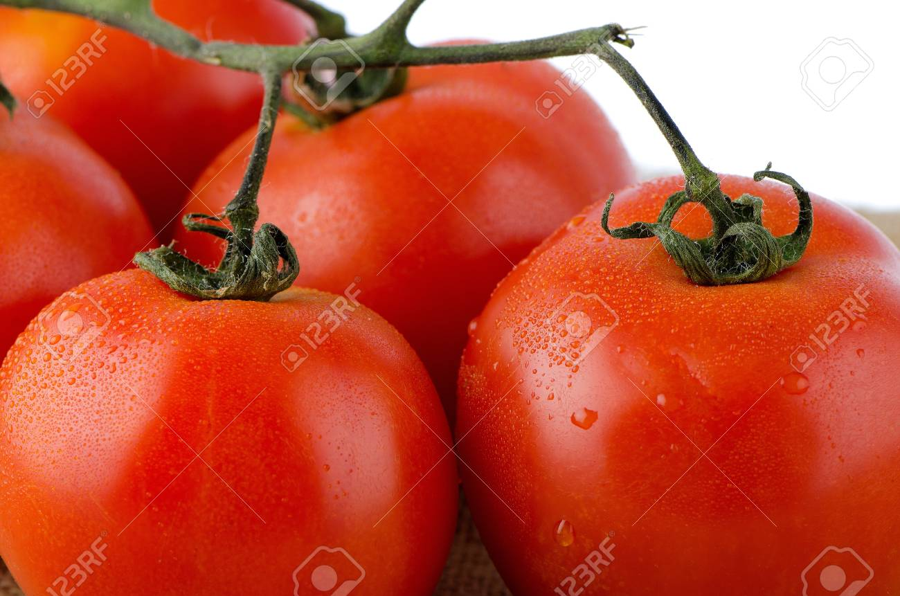 Cherry Tomatoes On The Vine Over Raffia Background Stock Photo 1300x861