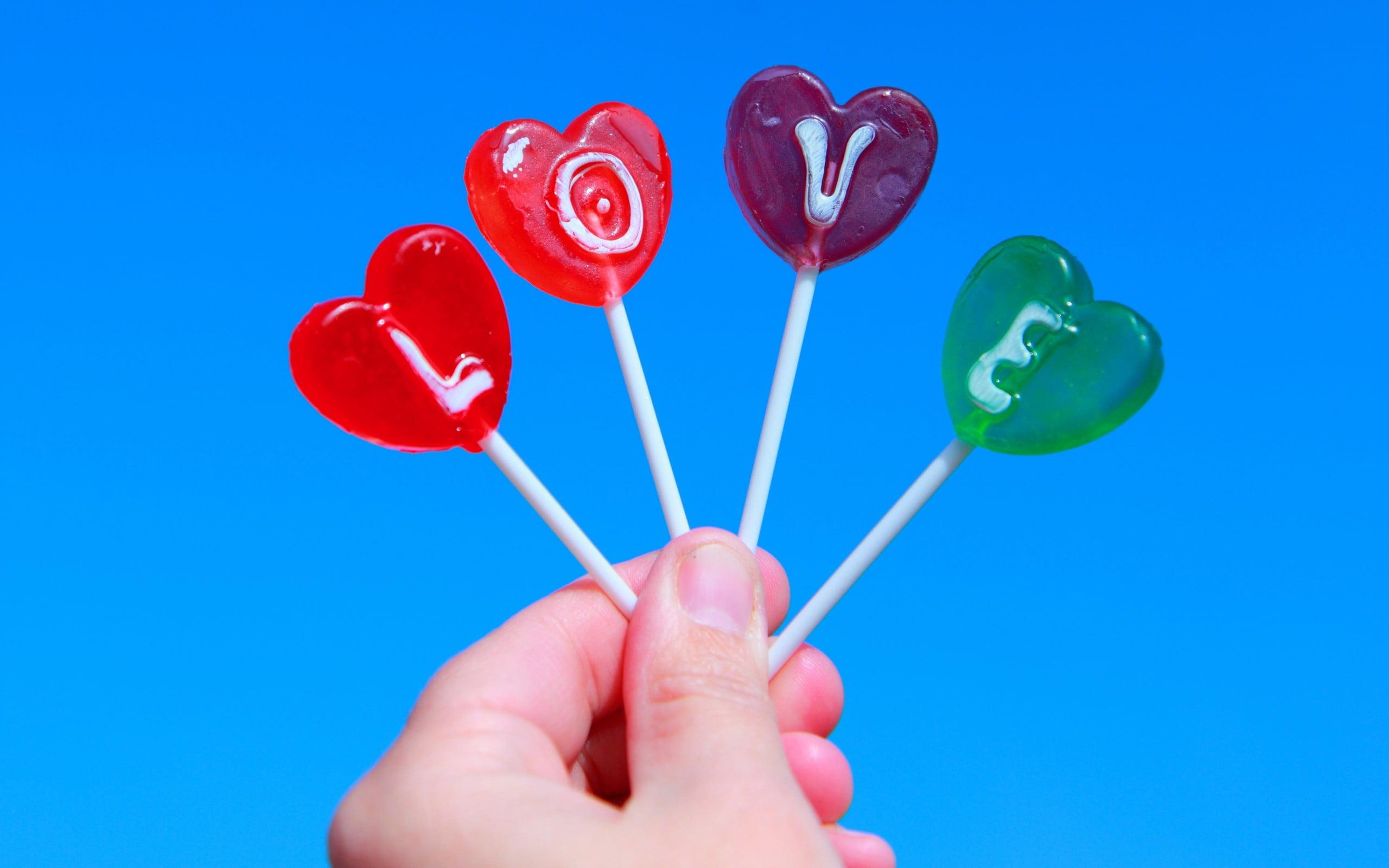 Four assorted color lollipops love candies HD wallpaper 2560x1600